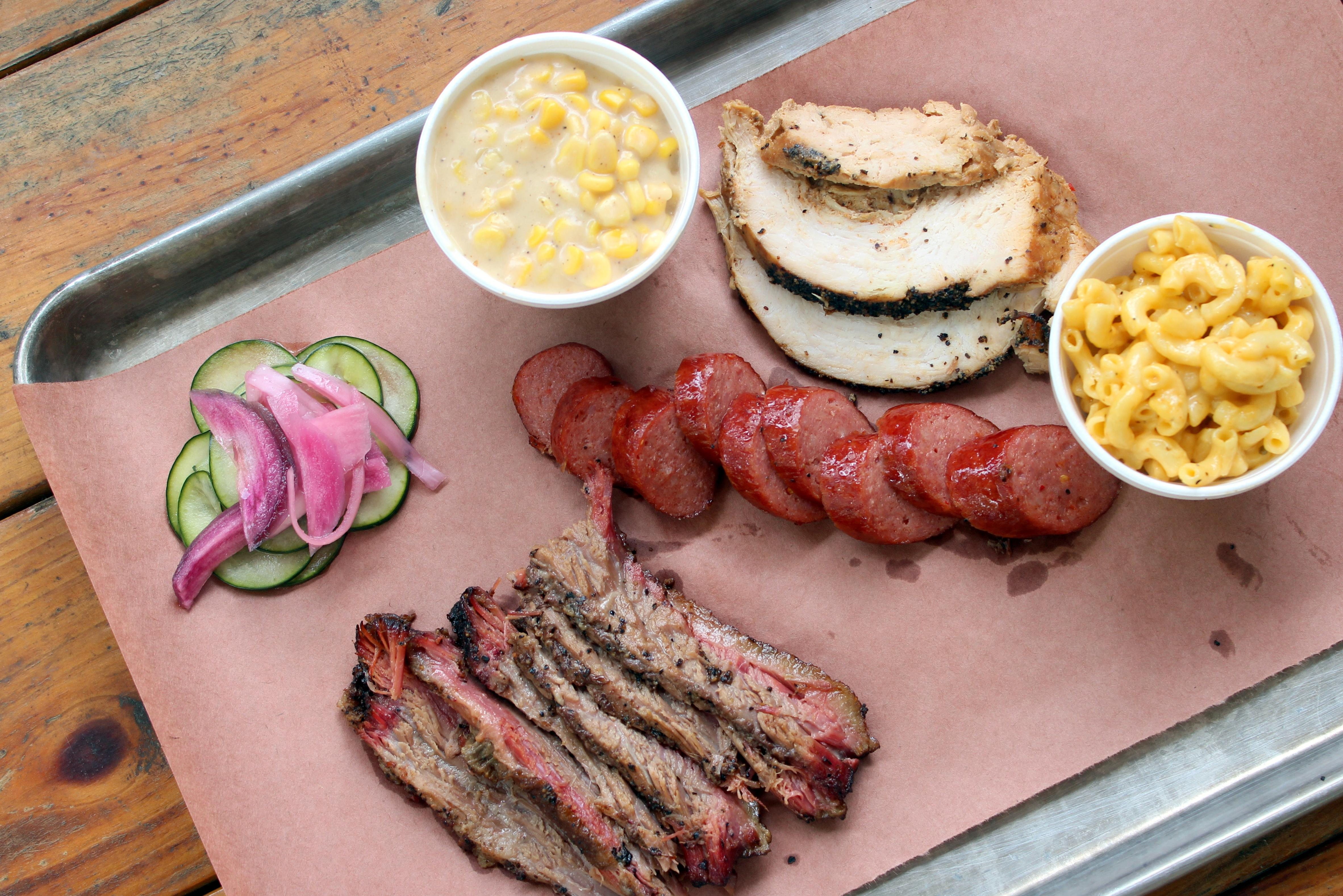 Restaurants across North and Northwest Austin, including Oakwood BBQ & Beer Garden off Braker Lane, remain open with takeout, curbside pickup and delivery options. (Amy Denney/Community Impact Newspaper)