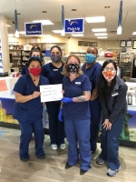 "A photo of five medical workers wearing hand-sewn masks and holding a sign that reads ""Thank you #MakeAMask sewers."""
