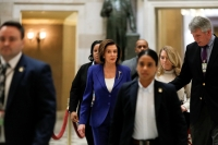 House Speaker Nancy Pelosi speaks to reporters while walking to the House Chamber floor, ahead of a vote on a coronavirus relief bill on Capitol Hill in Washington on March 27. (Courtesy Reuters/Tom Brenner)