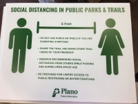 The city of Plano has placed signs at its various parks communicating social distancing guidelines. (Courtesy city of Plano)