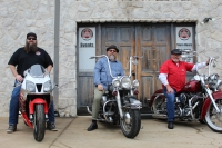 A Bikers Garage is a family business run by general manager Trenton Redenbaugh, at left, and owned by his father, Mike Redenbaugh, at right, and co-owner Bob Kay. (Ian Pribanic/Community Impact Newspaper)