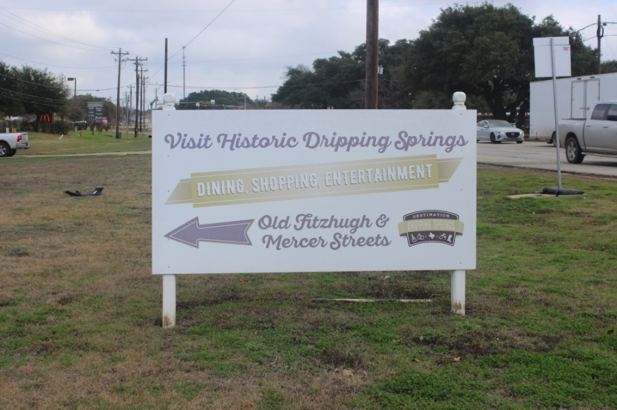 """A photo of a sign that reads """"Visit Historic Dripping Springs."""""""