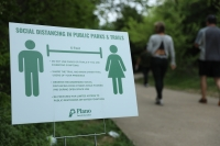 Social distancing signs have been placed in all Plano public parks. The city announced March 31 it would soon send employees to every major park in Plano to monitor visitors. (Liesbeth Powers/Community Impact Newspaper)