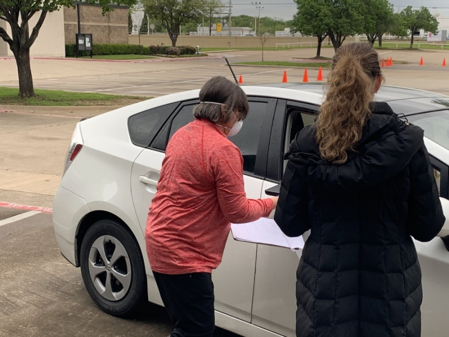 Grapevine-Colleyville ISD technology support staff organize cars in a drive-thru to provide technology repairs. (Courtesy Amy Taldo)