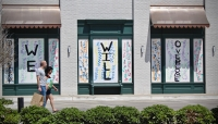 The windows at Goodnight Hospitality's property on Westheimer Road were boarded up with a message of hope for the small-business community. (Matt Dulin/Community Impact Newspaper)