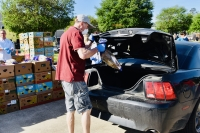 Volunteers unload food donations for the Montgomery County Food Bank. (Courtesy Drive West Communications)