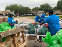 Volunteers help Friends of Sundown, a local chapter of Attack on Poverty, pack food from the Houston Food Bank to distribute Katy-area residents on March 25. (Courtesy Friends of Sundown)
