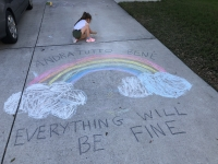 Emilia Shively draws a rainbow to inspire those who walk on her street. (Courtesy Tina Shively)