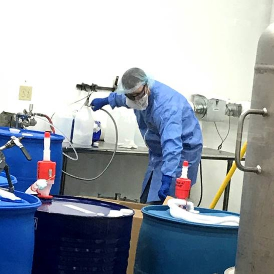 Workers at Inkjet Inc. are distilling hand sanitizer. (Courtesy Inkjet Inc)