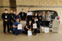 Medical professionals from Baylor Scott & White Medical Center-Centennial in Frisco received a donation of masks and assorted goodies from Two Men and A Truck on April 3. (Courtesy Two Men and A Truck)