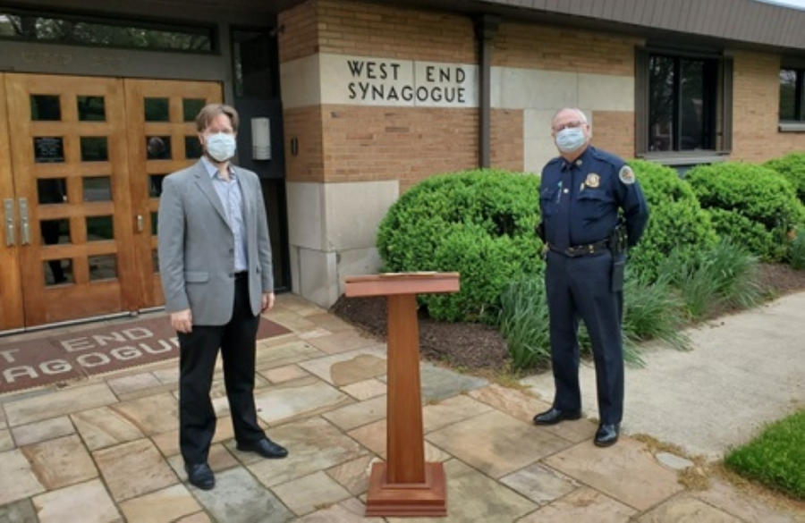 Rabbi Joshua Kullock and Metro Nashville Police Chief Steve Anderson participated in a Passover tradition April 8 while practicing social distancing guidelines. (Courtesy Metro Nashville)