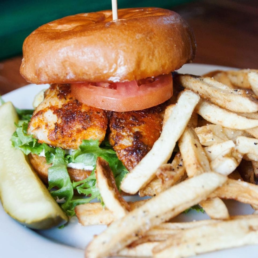 The restaurant's new blackened fish sandwich features blackened cod, tomato, lettuce and pickle on a brioche bun and served with a choice of side. This dish is available for curbside pickup and delivery. (Courtesy Olde Blind Dog Irish Pub)