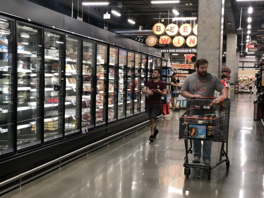 Shoppers in a Houston area store survey the products at H-E-B. (Nola Valente/Community Impact Newspaper)