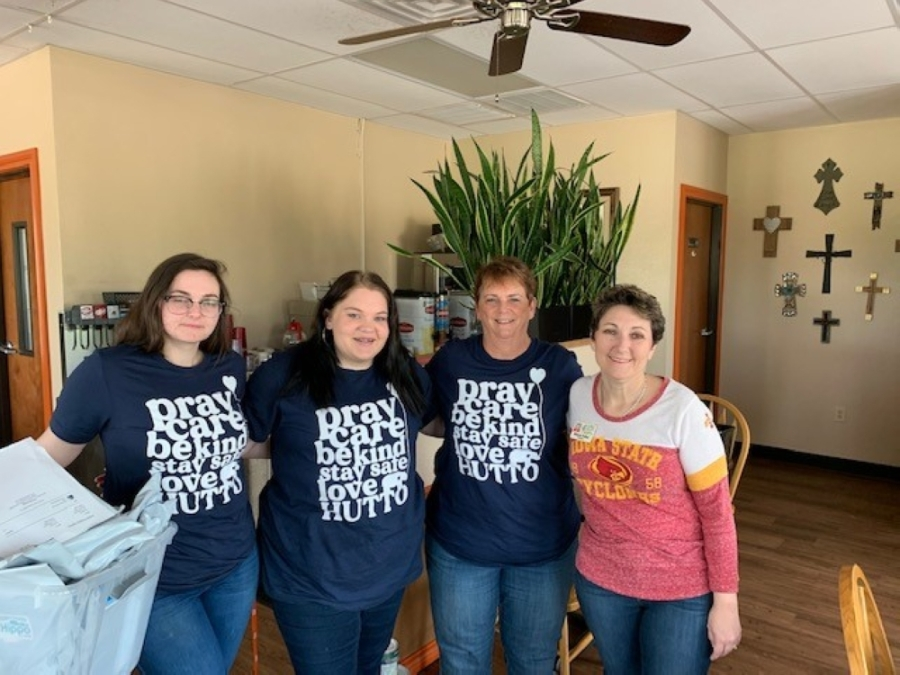 Brenda Renfrew (second from right), Hippo Cafe co-owner Stacie Feller (right) and restaurant staff package Love Hutto 2020 campaign shirts for shipment. (Courtesy Lance Renfrew)