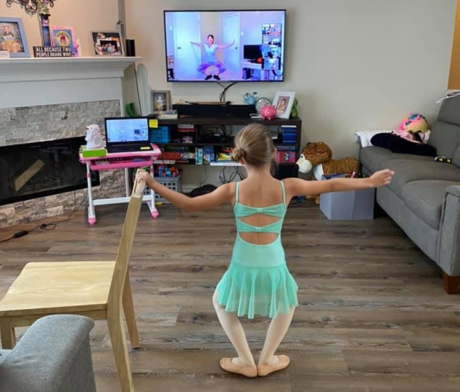 A member of the JDM School of Dance follows along with a virtual ballet lesson in her living room. (Courtesy JDM Dance)