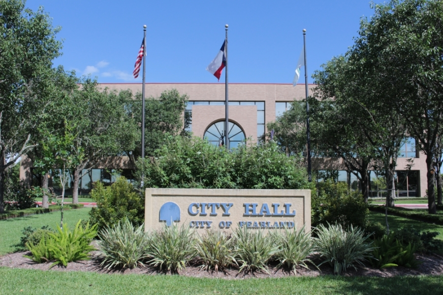 Pearland Mayor Tom Reid signed an order April 8 expanding food trucks' availability. (Haley Morrison/Community Impact Newspaper)