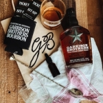 The Wayback Cafe & Cottages is offering a cocktail kit from Garrison Brothers including two glasses, bitters, a mixing spoon, a bottle of whiskey and more. (Courtesy The Wayback Cafe & Cottages)