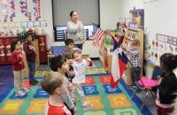 Pre-K teacher Sarah Rivera and her class at Block House Creek Elementary School in Cedar Park say the Pledge of Allegiance before class starts Feb. 19. (Brian Perdue/Community Impact Newspaper)