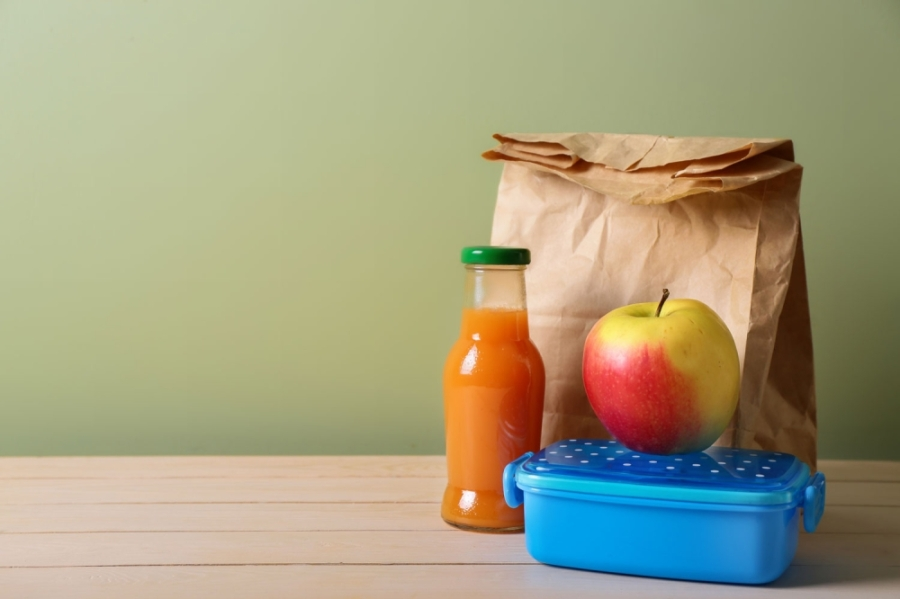 The district is working to clear lunch debts before school reconvenes. (Courtesy Adobe Stock)