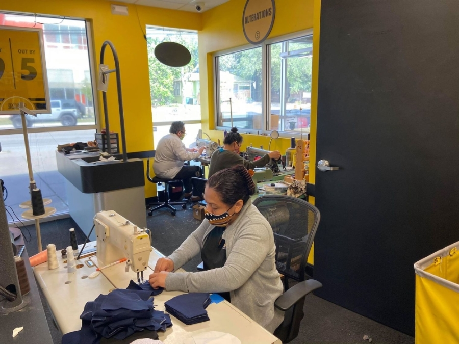 A photo of employees at ZIPS Dry Cleaning making masks