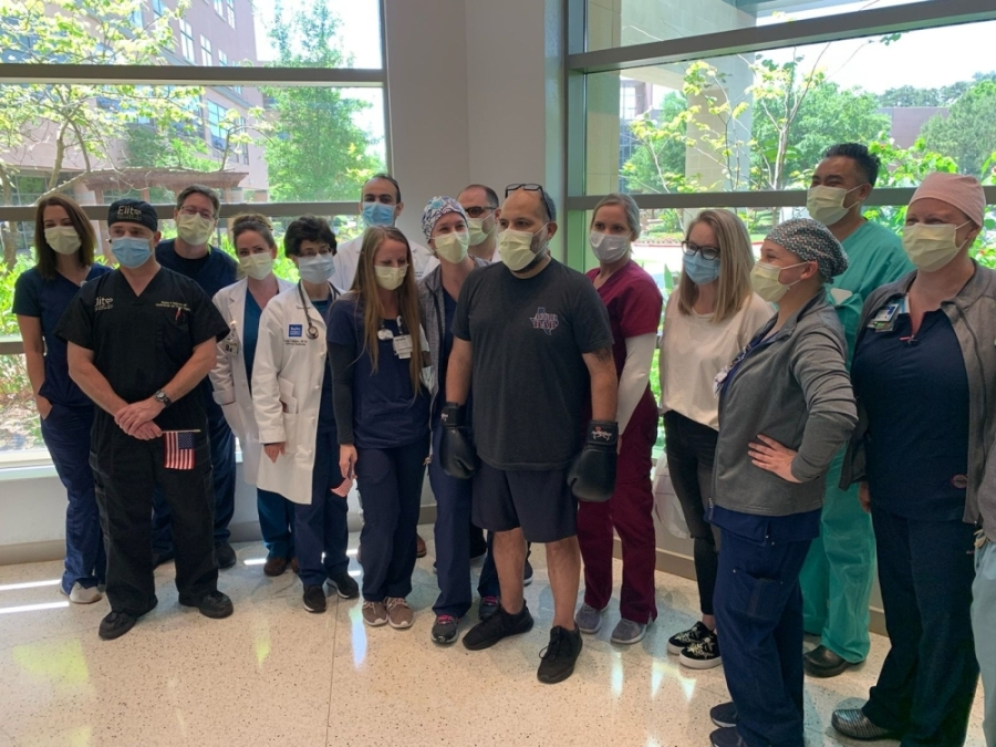 Chris Hernandez, center, stands with members of the CHI St. Luke's Health—The Woodlands Hospital staff prior to leaving the facility after weeks of treatment and recovery. (Courtesy CHI St. Luke's Health—The Woodlands Hospital)