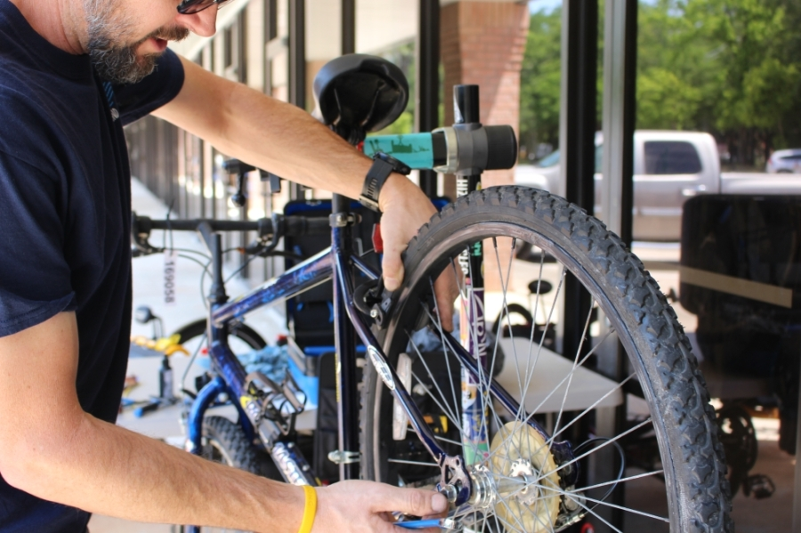 Longtime customer Mark Wood volunteered his time on April 15 to help Tailwind Bicycles work through its plethora of orders that have come in since stay-at-home orders were issued. (Kelly Schafler/Community Impact Newspaper)