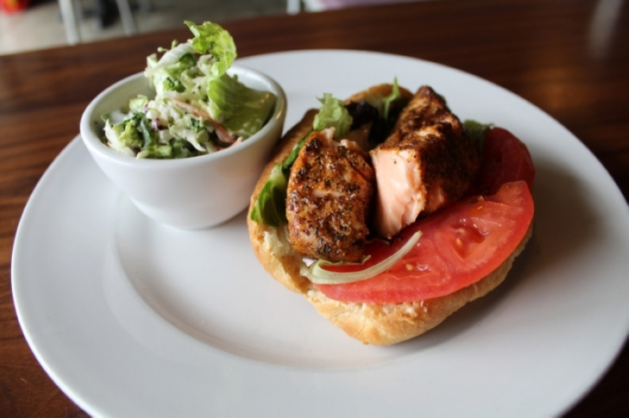 Alpharetta restaurant Wildflour's menu includes the salmon sandwich. Wildflour is one of the restaurants remaining open for takeout and delivery via DoorDash while dine-in services are temporarily suspended due to the outbreak of COVID-19. (Kara McIntyre/Community Impact Newspaper)
