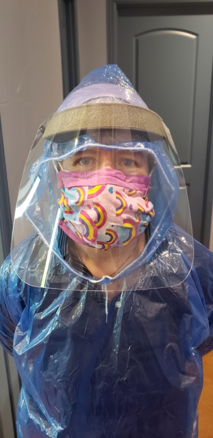 Dr. Emily Briggs wears an assortment of protective equipment for COVID-19 testing due to a shortage of PPE.