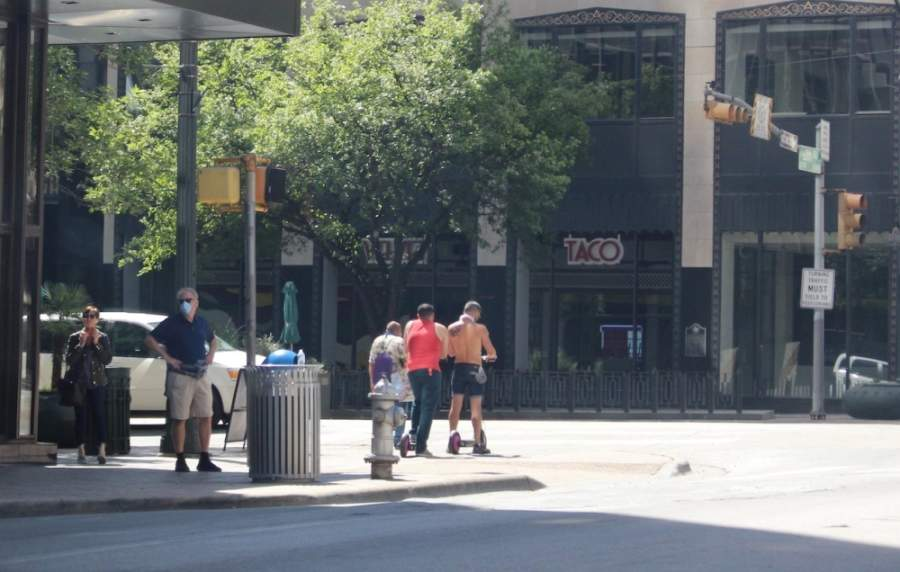 Residents walk in downtown Austin on April 16. (Nicholas Cicale/Community impact Newspaper)