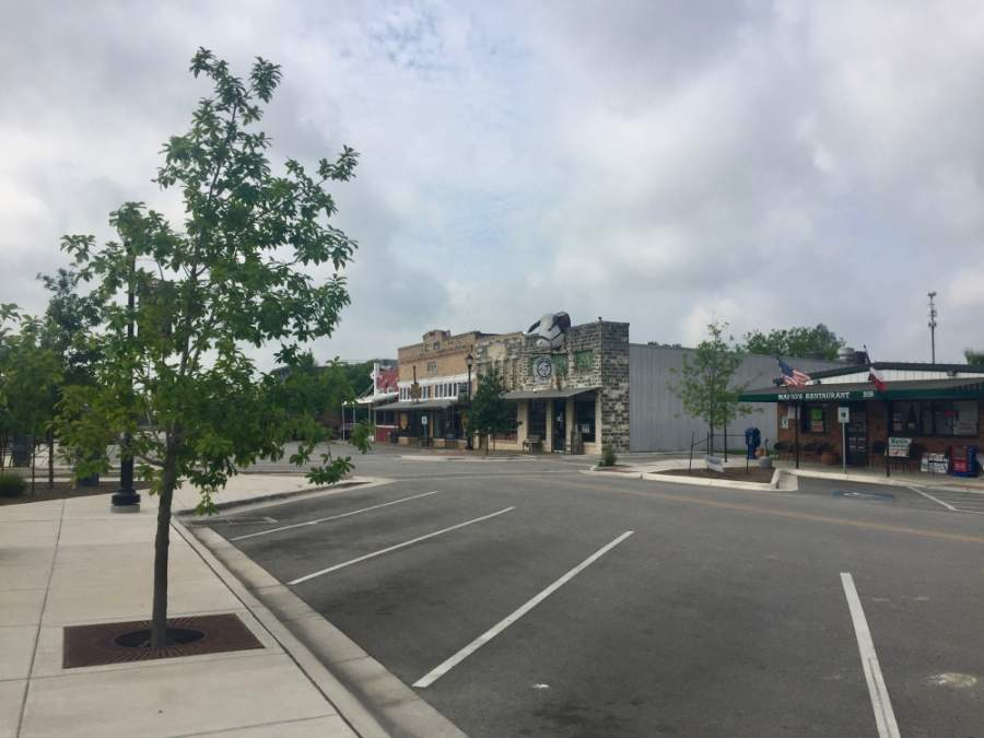 East Street was empty on a Tuesday at noon. All nonessential businesses remain closed at this time, and residents have been ordered to stay at home amid the coronavirus pandemic. (Taylor Jackson Buchanan/Community Impact Newspaper)