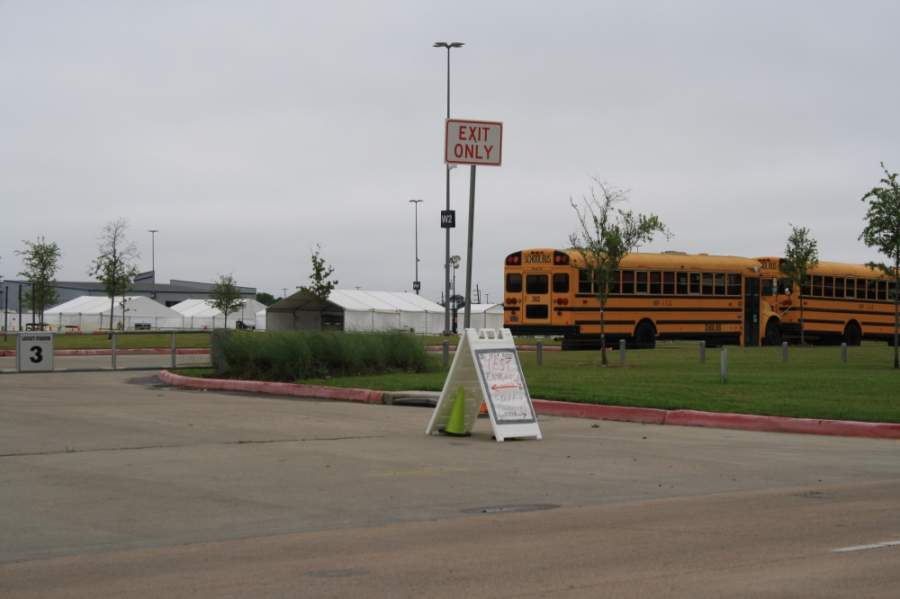 Katy ISD buses line the Legacy Stadium parking lot where patients can get tested for the coronavirus. (Jen Para/Community Impact Newspaper)