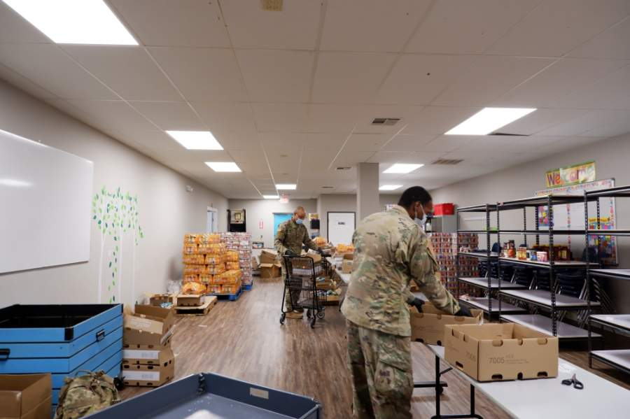 On Wednesday, April 22, members from the U.S. National Guard reported to assist food unboxing and distributions at Bridging for Tomorrow's food pantry, doubling the nonprofit's staff for the day. (Courtesy Bridging for Tomorrow)