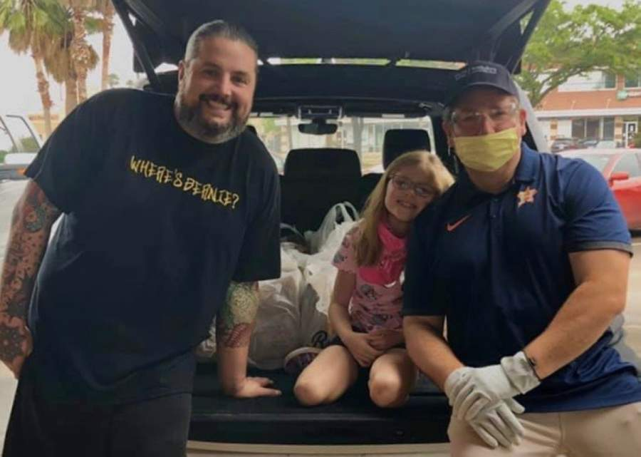 David Atkins and his family delivered 150 meals from Bernie's Burger Bus to Bellaire, Meyerland, Westbury and Willow Meadows residents April 19. The family will continue those efforts April 25. (Courtesy David Atkins)