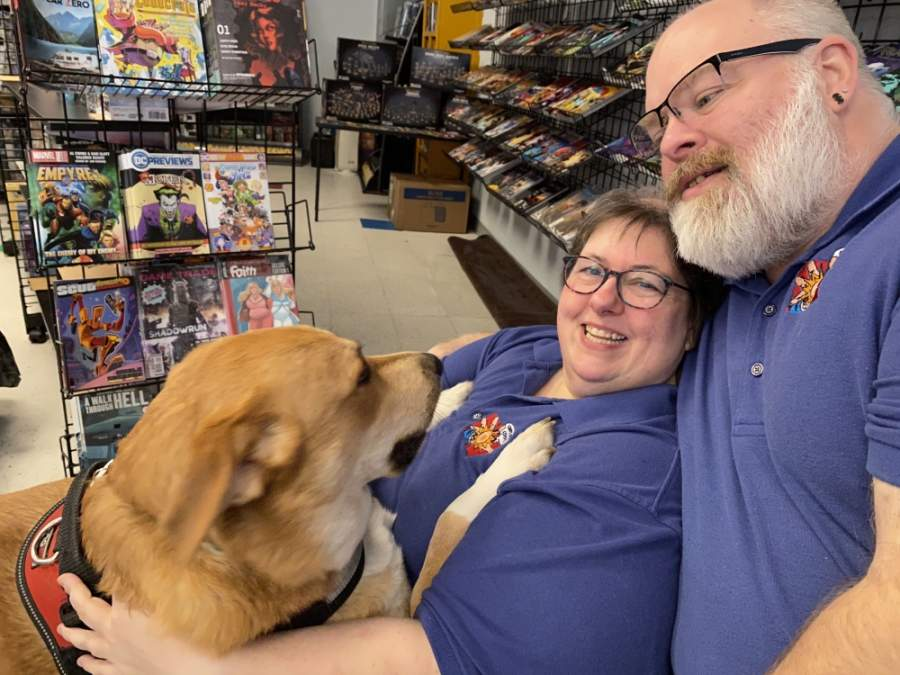 "Melyssa ""Lys"" Childs-Wiley and Shannon ""Shado"" Wiley opened Carpe Diem Comics on Memorial Day in 2018. Their dog, Pancake, keeps them company at the shop. (Renee Yan/Community Impact Newspaper)"