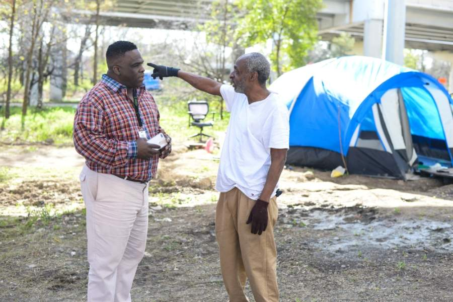 SEARCH outreach specialist Otha Norton, left, assists Carlton Ray and records data in a multi-agency information system for tracking Houston's homeless population. (Courtesy Lauren Anderson)