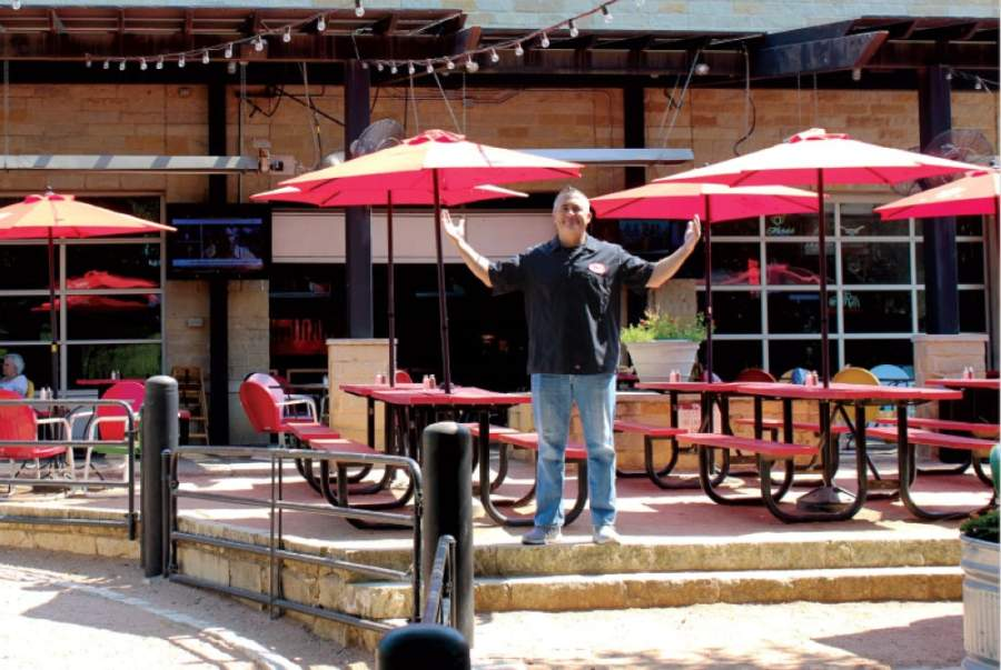 Doc's Backyard owner Charles Milligan is preparing to reopen the restaurant's dining room and patio this week. (Nicholas Cicale/Community Impact Newspaper)
