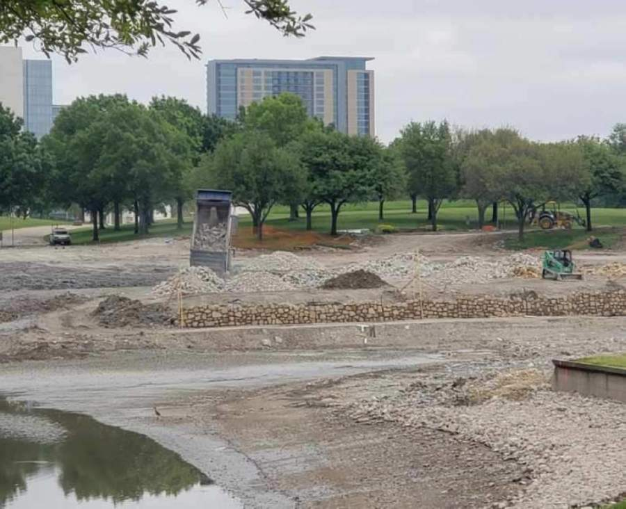 Crews have nearly completed the reconfiguration of the pond at the former J.C. Penney campus. The pond will be shrunk to make room for a Miyako Hotel as well as other new buildings as part of The Campus at Legacy West mixed-use development. (Courtesy Sam Ware/Dreien Opportunity Partners)