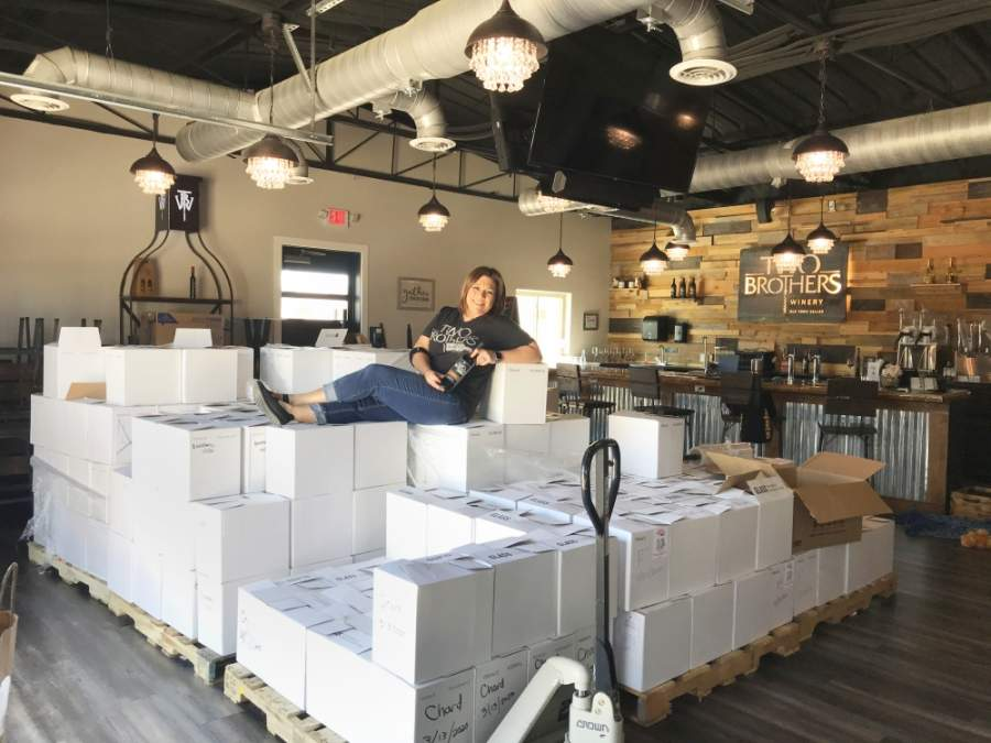 Two Brothers Winery co-owner Donna Kirkwood moved inventory out of storage as she shifted to new sales strategies. (Cass Clements/Community Impact Newspaper)