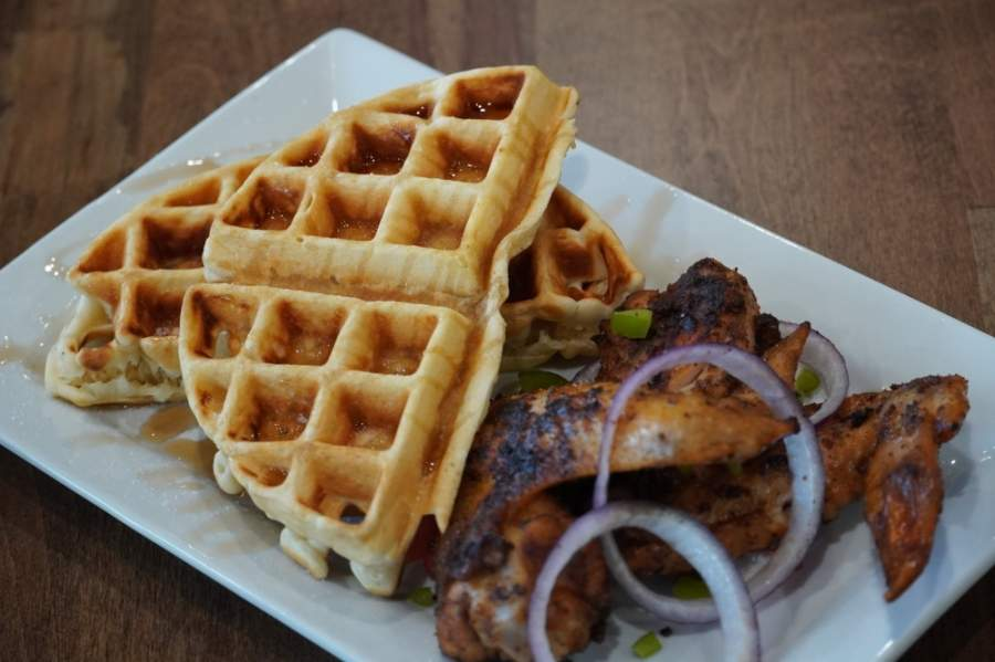 The menu includes suya wings and waffles. (Courtesy Fusion Vibes Kitchen + Bar)