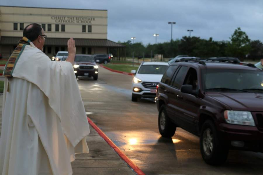 "More than 100 cars fill the parking lot as Christ the Redeemer Catholic Church in Houston holds its first ""drive-in benediction"" event for its congregants March 20. The Diocese of Austin announced it will resume public Mass on May 5. (Courtesy Christ the Redeemer Catholic Church)"