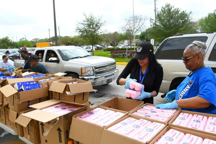 The Saturday event at the yellow parking lot of NRG is expected to distribute 10,000 food packages—approaching 1 million pounds—in five hours, from 2-7 p.m. (Hunter Marrow/Community Impact Newspaper)