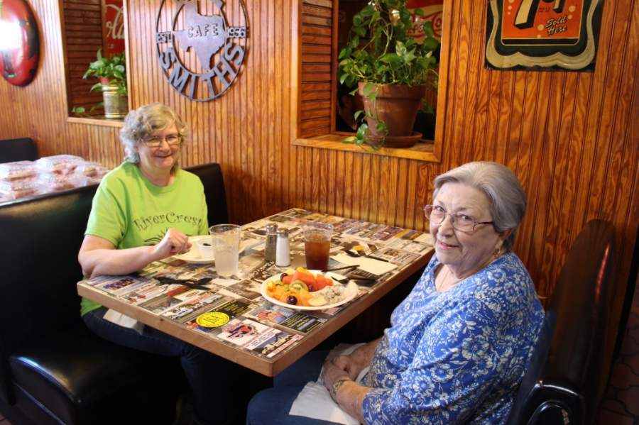 From left to right, Kay Hefner and her mother, Estelle Sanders, are back the first day the doors reopen at Bill Smith's Cafe in McKinney. (Miranda Jaimes/Community Impact Newspaper)