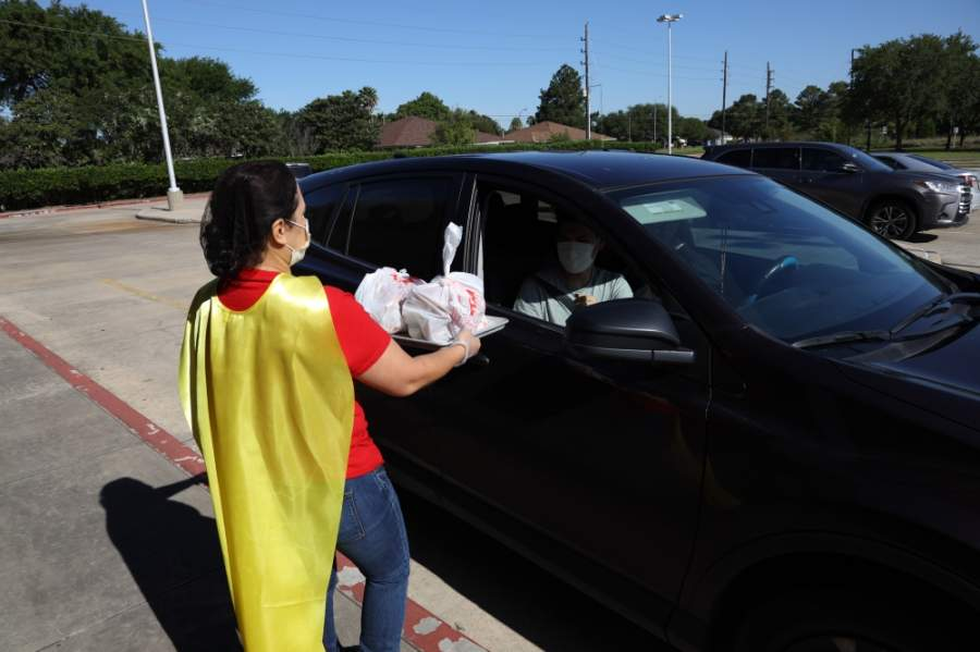 Katy ISD celebrated School Nutrition Hero Day on May 1 to thank its nutrition and food service employees for their hard work. Employees dressed as superheroes as they gave out free meals to children. (Courtesy Katy ISD)