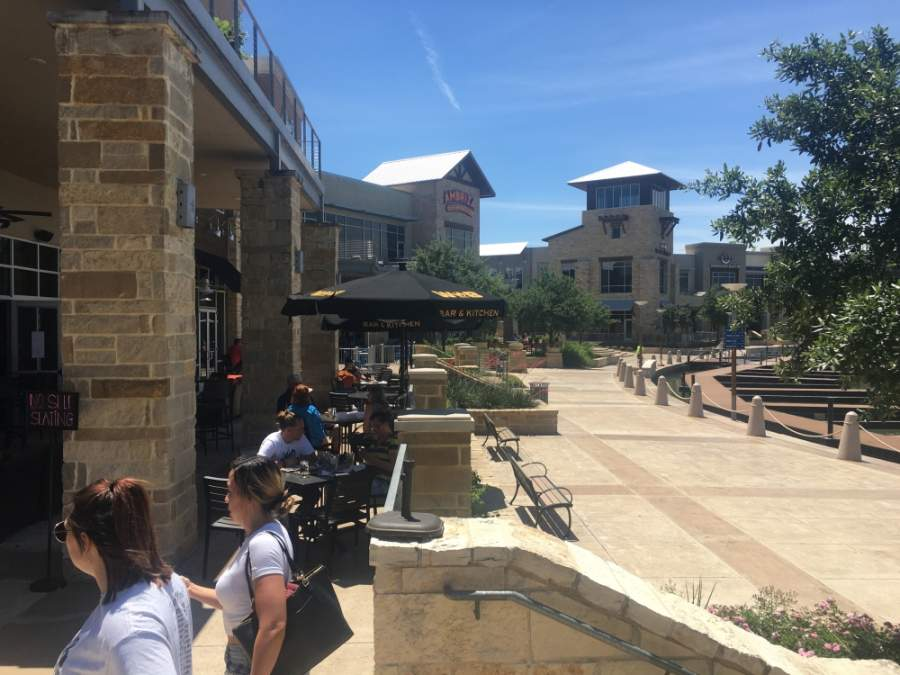 Diners sit outside at World of Beer at the Boardwalk at Towne Lake in Cypress, which reopened for dine-in service with limited capacity May 1. (Shawn Arrajj/Community Impact Newspaper)