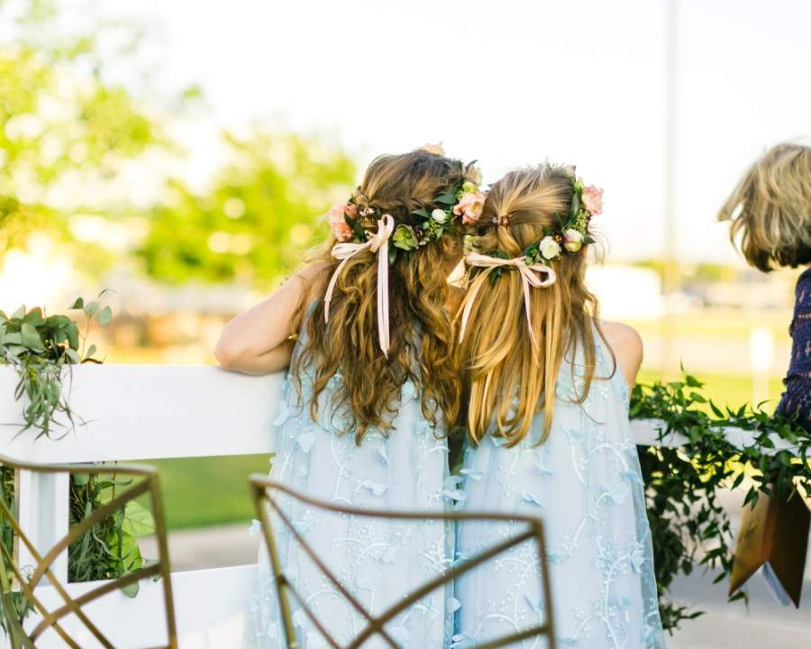 two flower girls, from behind