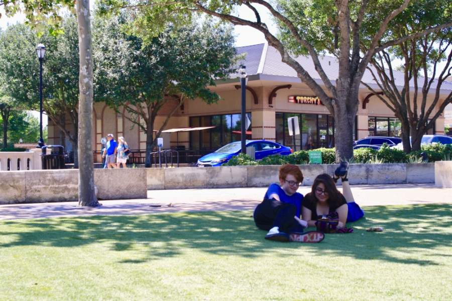 Residents hang out and walk around LaCenterra at Cinco Ranch on May 3. Some stores and restaurants had been reopened. (Jen Para/Community Impact Newspaper)