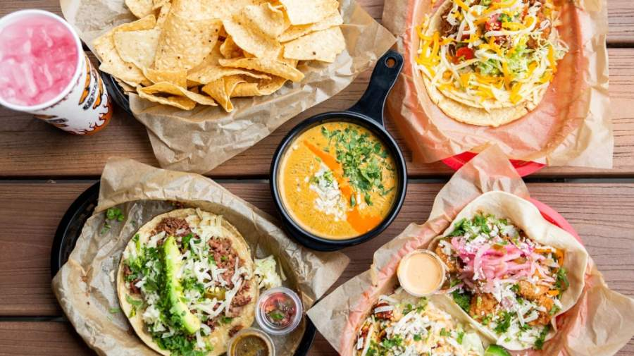 Here are 25 restaurants offering takeout, dine-in services and to-go margaritas to help put you in the festive spirit. (Courtesy Torchy's Tacos)