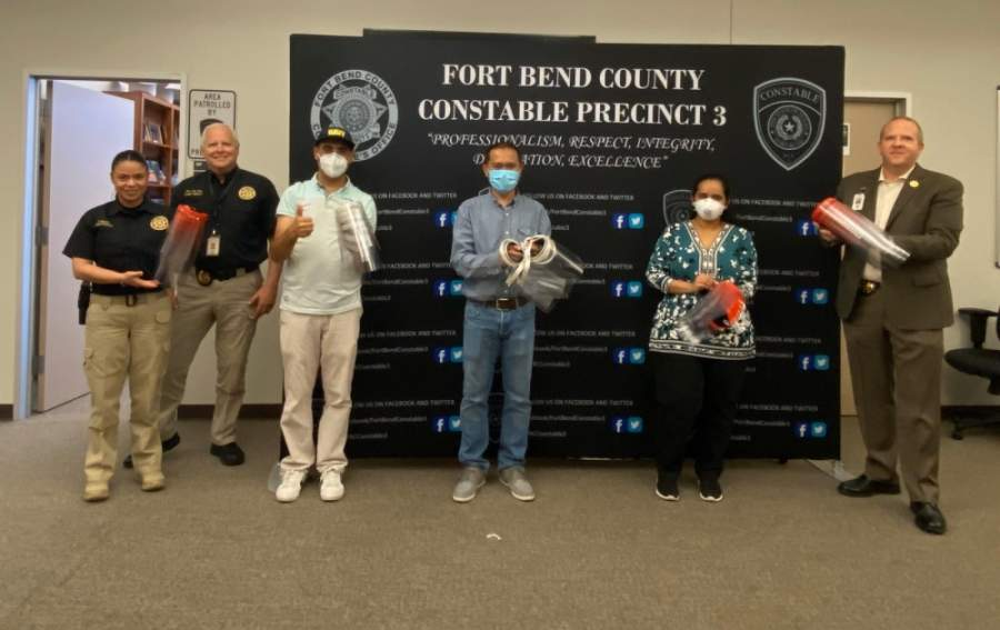 Harmony School of Innovation-Katy and Harmony Science Academy-Sugar Land gave 45 shields to the Fort Bend County Precinct 3 Constable's Office on May 4. (Courtesy Harmony Public Schools)