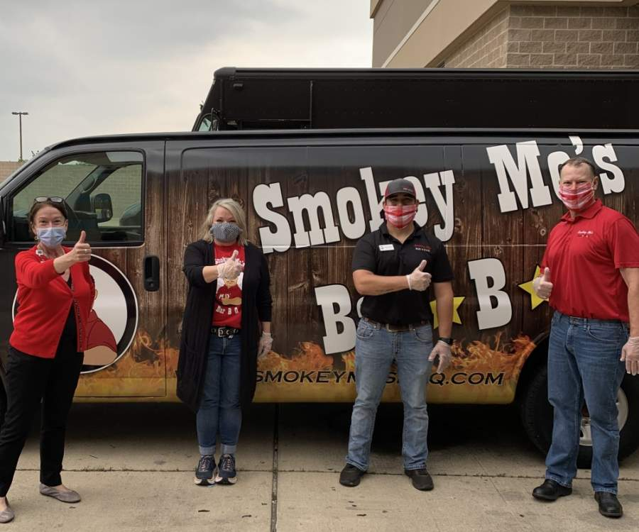 Smokey Mo's BBQ employees prepare to deliver meals to Cedar Park Regional Medical Center on May 5. (Courtesy Smokey Mo's BBQ)