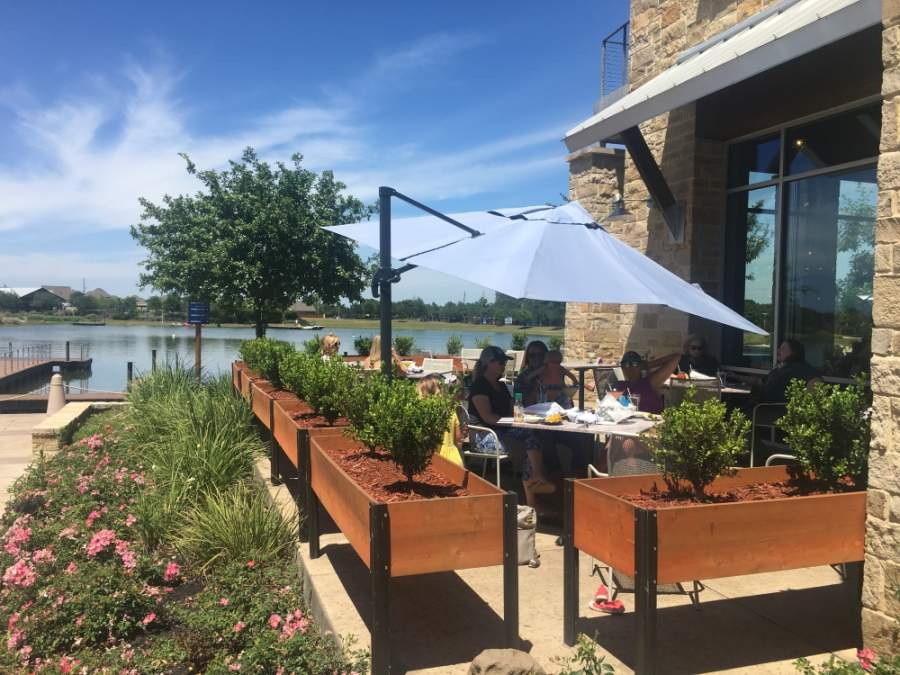 At Ambriza Social Mexican Kitchen, where tables overlook the water at the Boardwalk at Towne Lake, the ability to reopen for dine-in service has been well-received. (Shawn Arrajj/Community Impact Newspaper)